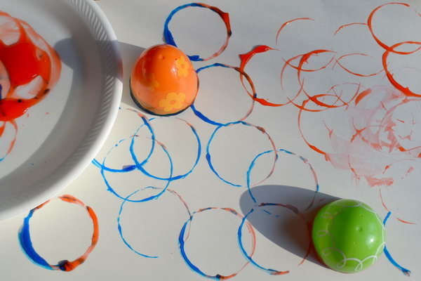 Circle Prints Easter Activity. Use the half Easter egg to dip the paint in a paper plate. Press colorful circles on paper. You can get this artistic painting easily.