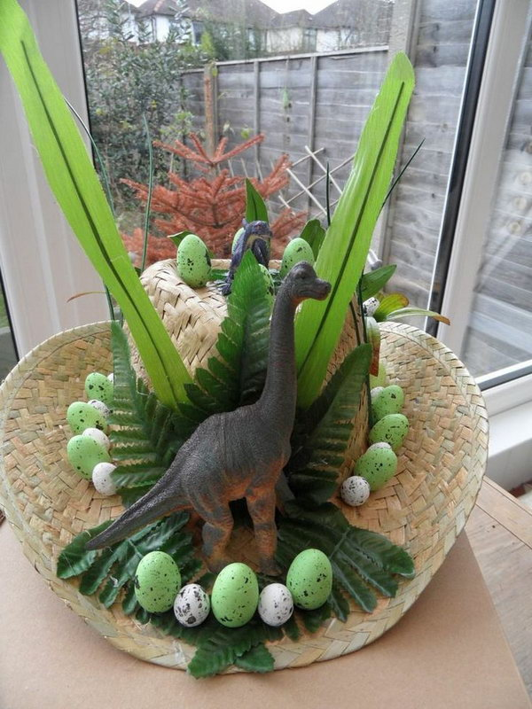 Dinosaur Easter Bonnet. This dinosaur Easter hat is so cool. Buy a large-size straw hat, then decorate it with dinosaurs, Easter eggs and leaves, you'll get this amazing art-piece.