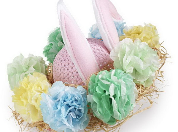 Rabbit Flower Pom Easter Bonnet. Secure raffia around the brim of your bonnet. Attach the ears to your bonnet and decorate it with fuller flower poms made of tissue paper of multi-layers.