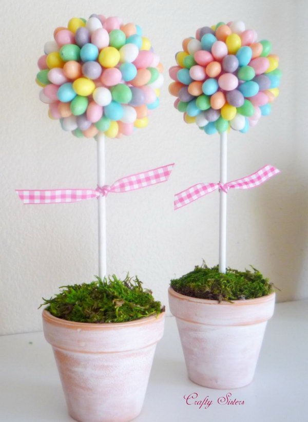 Jelly Bean Topiary. This cute and romance-themed jelly bean topiary adds a fresh spring flavor for your Easter decoration. Glue each jelly bean onto a pink Styrofoam ball add floral foam to anchor the dowel into and cover it with moss.