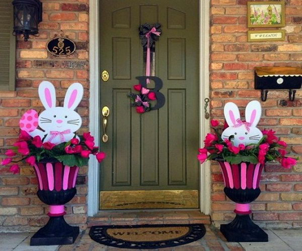Easter Bunny Decoration. The cute Easter bunny in the decorated flowerbed makes this decoration style live and funny. The left one holds the Easter egg while the other one tries to hide in the flowerbed.