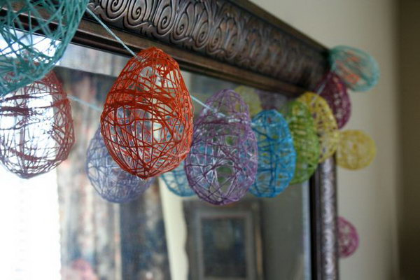 Easter Egg Garland. Make these colorful Easter eggs with strings wrapping around the water balloon. When the shape is almost done, you can pop it. Glue these eggs on the string, you can hang it around the door, the window as you like.