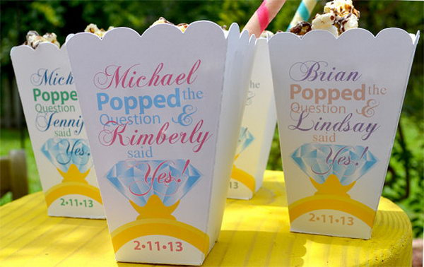 Engagement Party Popcorn Box Favors. Fill the celebration of the engagement party with caramel corn popcorn and wrap them in a cute gourmet popcorn bar for a party favor. You can personalize your favor with names written on them.