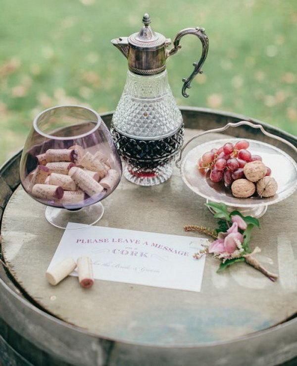 This Vineyard Cork Guest book is an easy way to get your guests leave quick notes or wishes during your reception. You can display the corks as a unique wall art for sweet memories.