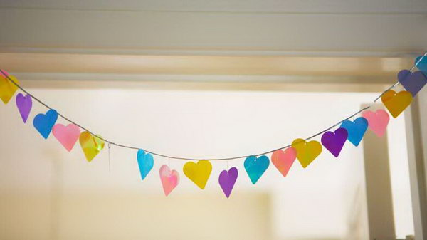 Colorful Paper Wedding Garland. For beautiful backdrop decorations with low cost, you can try this easy made garland using oversize paper punch to make cutouts in shapes as you like. String them through to get your wedding reception dolled up with this beautiful backdrop.