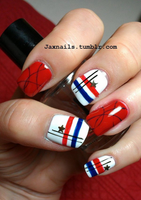 Fireworks Nail Art: Enjoy the fireworks fun with this pretty polish. Use a small nail art brush or toothpick to draw tiny lines and add golden stars to nail art gems for this explosive look.