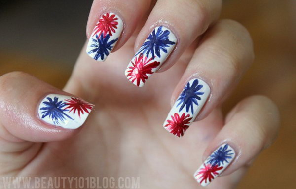 """Patriotic Fireworks Long Nail Design: If you in love with watching the fireworks and you have long nails. This beautiful fireworks nail design is just for you. The fancy look is actually simpler than it seems. Use blue and red color to draw an """"X"""" on the white base coat. Then keep adding to it until you get the firework as big as you want. Head over to the tutorial."""