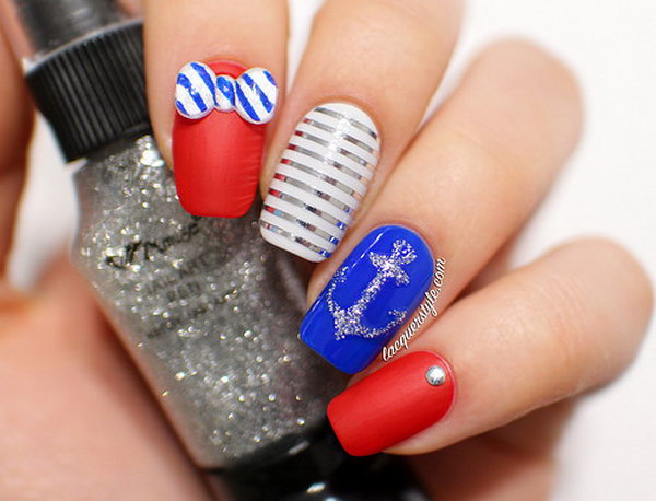 4th of July 3D Striped Bows Accented Nails:  This 3D striped bows design is a funny take on navy-inspired nails. Start with blue, white and red alternating bases, then draw the silver anchor and clean stripes with nail art pens. Add a silver stud and the striped bows and it's done. See the tutorial