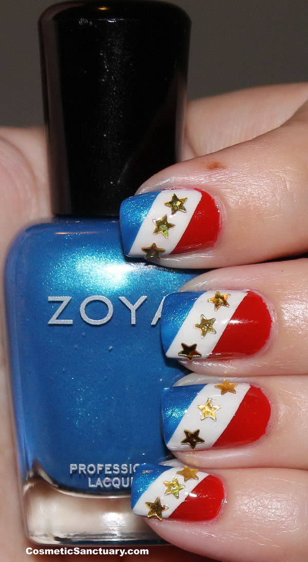 Patriotic Gradient Stripes with Accented Sparkling Stars Nautical Nails: If you're loving this adorable manicure and want to recreate something like this, please head over to check out the tutorial here.