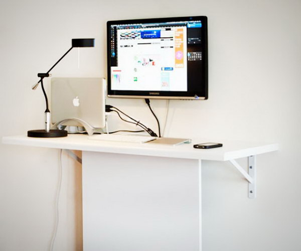 Very Functional Cheap DIY Standing Desk. It's made of an IKEA kitchen bench cut to the right size and an another IKEA board that hides external HDDs and all cords.