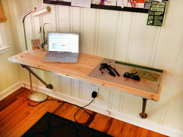 Wall Mounted Desk with Angled Supports. This simple but stunning desk leverages existing structures to save you time and money. The instructions are easy-to-follow and make for a fantastic weekend project if you're looking to create a custom desk area.