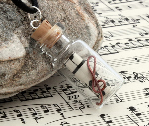 Sheet Music Glass Vial Pendant. This cute little glass vial pendant allows you to take your love for music with you in a way that doesn't include your mp3 player!