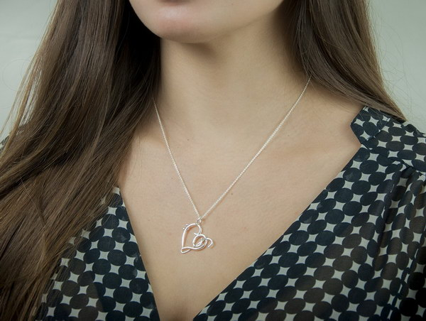 Heart of Treble and Bass Clefs Silver Necklace . This unique jewelry makes a nice gift for a music lover. Having the heart be comprised of a treble clef and bass clef is very unique.