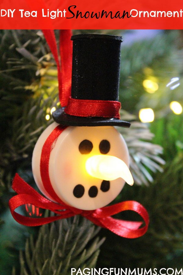 Tea Light Snowman Ornaments. What an easy but cute DIY Christmas craft idea for the frugal gift-givers. Send your neighbors little tea light snowman ornaments to hang on their Christmas trees.