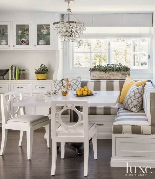 Transitional White Breakfast Nook with Striped Banquette Seating.