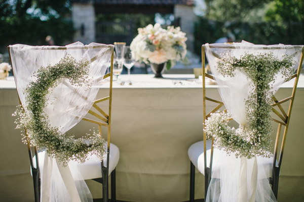 Baby's Breath Monograms on Bride and Groom's Chair
