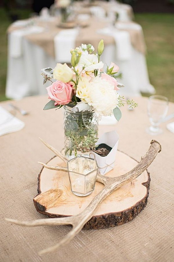 Antler and Flowers in Jars on a Wood Round Centerpiece