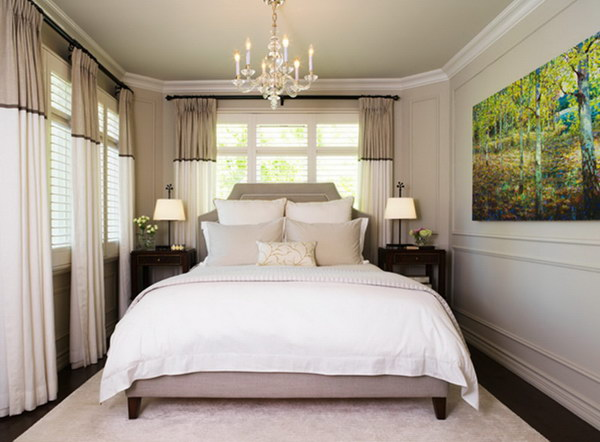 Stripes on the walls, curtains and headboard make this small gray bedroom look bigger.