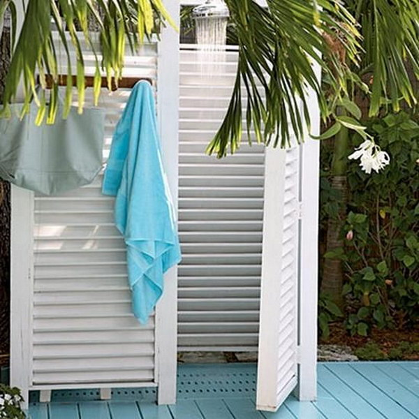 Outdoor shower with White Shutter Dividers Surround for Privacy.