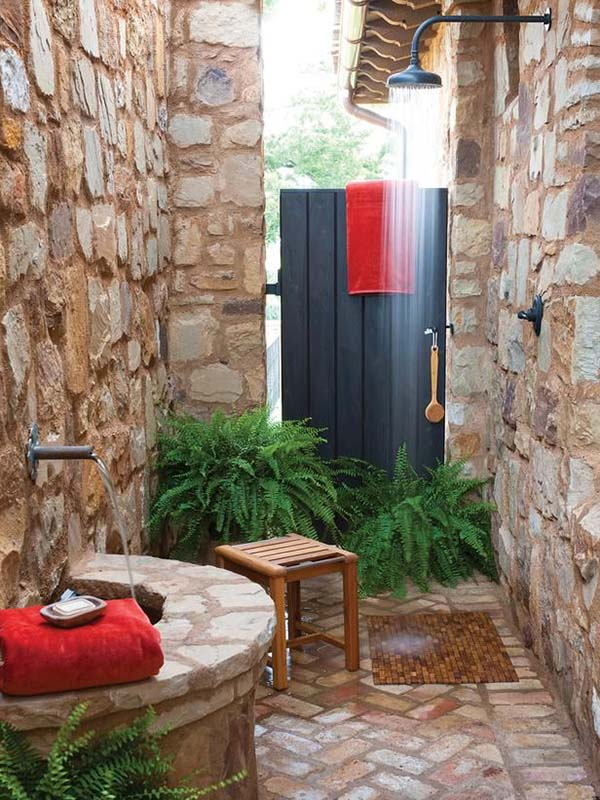 Stone Walled Outdoor Shower With Wood Stool.