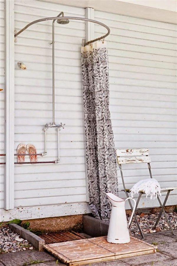 Simple Outdoor Shower with Curved Shower Curtain Rod.