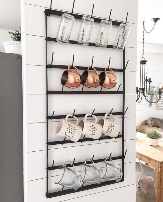 Black Metal Shelf With Hooks for Mugs.
