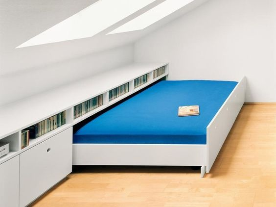 Create a Guest Bedroom in the Attic with Storage Space and Pull out Bed.