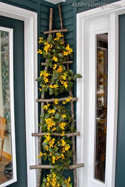 Decorate the Front Porch with DIY Birch Ladder.
