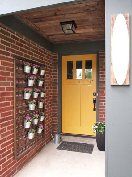 Decorate the Front Porch with This DIY Vertical Wall Planter.