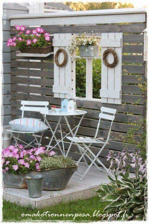 Create a Sitting Area with Pallet Wood and Old Shutters.