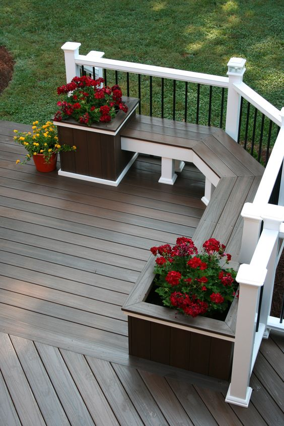Add a Deck Bench with Potted Plants for a Relaxing Place to Sit.