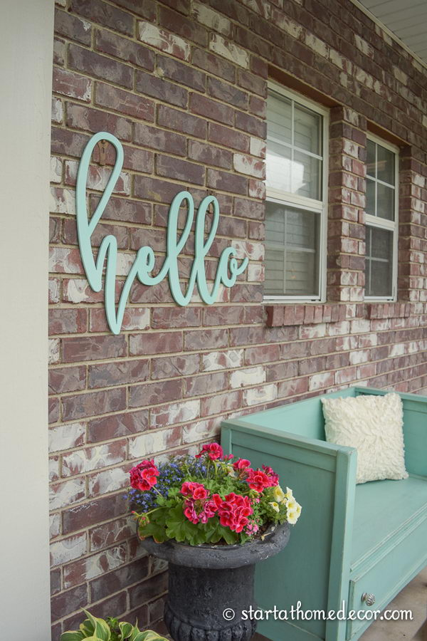 Add Character to Your Porch with a Simple Hello Welcome Sign.