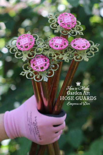 DIY Garden Art Hose Guards Made from Kitchen Drawer Pulls.
