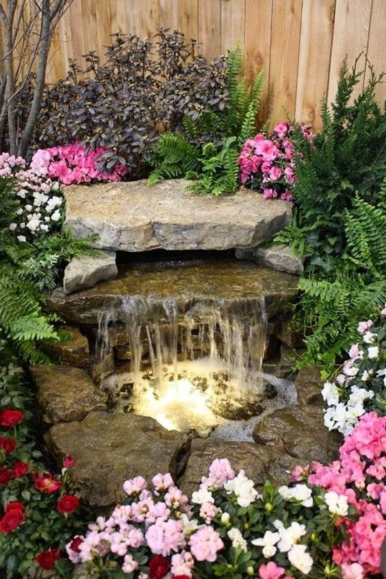 Waterfall Fountain With Pond And Stone.